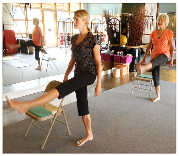 Photo of Mother and Daughter in Pilates Class
